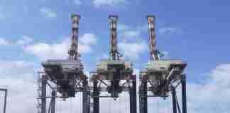 Tre gru al porto di Gioia Tauro